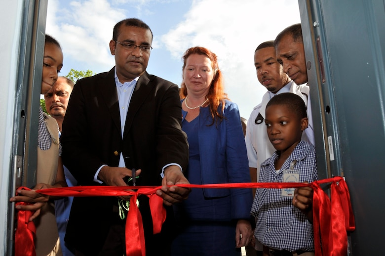 Bharrat Jagdeo, President of Guyana, cuts the ribbon to the new medical clinic Sept. 10, 2009, at the La Pentinence Medical Clinic in Georgetown, Guyana. The $350,000 structure was built by Soldiers of Georgia Army National Guard.  (U.S. Air Force photo by Airman 1st Class Perry Aston) (Released)