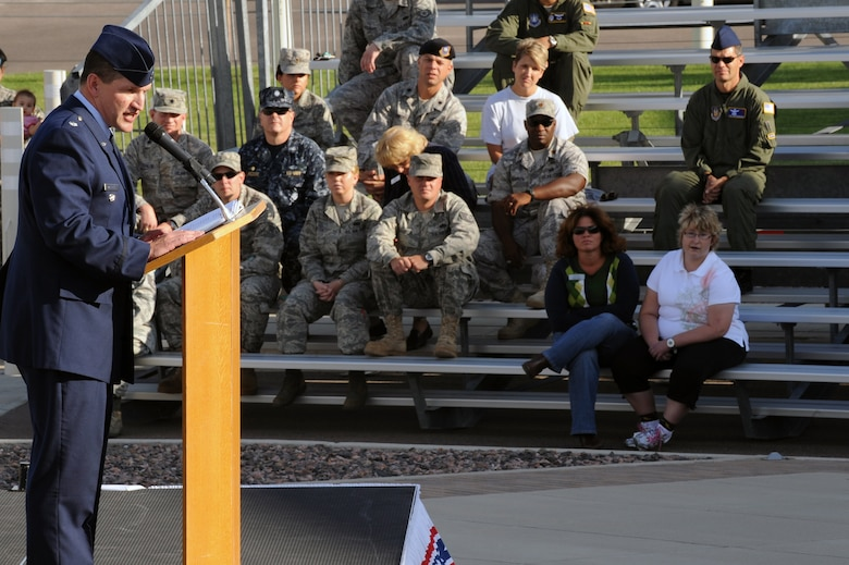 BUCKLEY AIR FORCE BASE, Colo. – Lt. Col. William Morrison, 460th Mission Support Group deputy commander, speaks at Buckley's Patriot Day ceremony Sept. 11. During the ceremony, Team Buckley remembered those who died Sept. 11, 2001, during the attacks on the World Trade Centers in New York, the Pentagon and on United Airlines Flight 93 over Pennsylvania. (U.S. Air Force photo by Senior Airman John Easterling)