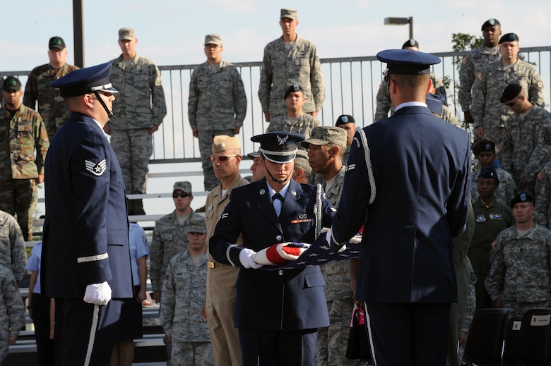 BUCKLEY AIR FORCE BASE, Colo. - The Buckley Air Force Base honor guard perform a flag-folding ceremony during the Patriot Day ceremony Sept. 11. (U.S. Air Force photo by Senior Airman John Easterling)