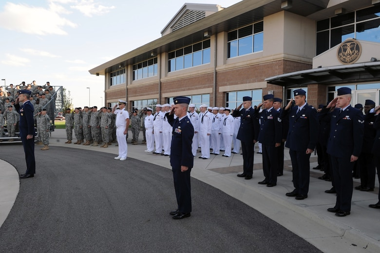 BUCKLEY AIR FORCE BASE, Colo. - Team Buckley members stand in formation during the Patriot Day ceremony Sept. 11. The United States flag was lowered to half-staff during Patriot Day in remembrance of the lives lost in 2001. (U.S. Air Force photo by Senior Airman John Easterling)