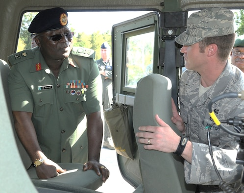 RAMSTEIN AIR BASE, Germany -- Nigerian Armed Forces Maj. Gen. Pennap receives an orientation on a rapidly deployable Hummer from ground radio operator Staff Sgt. Ronald Booth of the 435th Contingency Response Group Sept. 11 here. The General was part of a group of Nigerian military officials who visited Ramstein as part of a visit to U.S. Africa Command. They received a series of orientations to provide information and the basis for continued cooperation between U.S. and Nigerian forces.  The group was hosted at Ramstein by 17th Air Force (Air Forces Africa). As the air component for U.S. Africa Command, 17 AF has been partnering with Nigeria, and conducted three engagements with the nation in August. (USAF photo by Master Sgt. Jim Fisher)