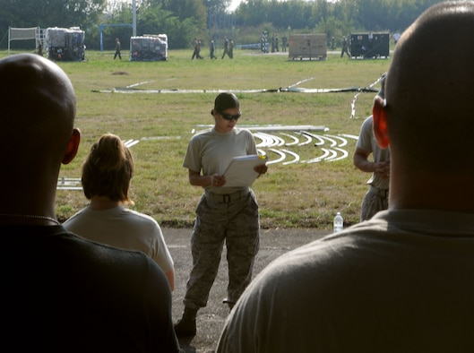 Staff Sgt. Melanie Hernandez, 458th Expeditionary Medical Squadron, briefs Airmen on the plan to set up tents for a mobile hospital Tuesday, Sept. 1, 2009, in Nis, Serbia. The 458th EMEDS stood up in support of the 2009 Military Medical Training Exercise in Central and Eastern Europe Sept. 2 – 13. The exercise, hosted by Serbia, provides a joint medical learning environment and assists host nation civilian and military services; international, private and volunteer organizations; and other participating nations in enhancing disaster response actions. Fifteen nations participated in the exercise. (U.S. Air Force Photo/Senior Airman Alex Martinez)