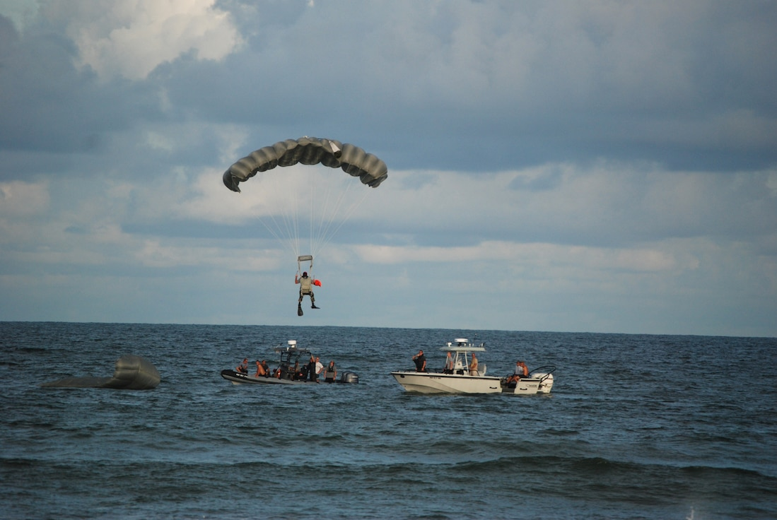 COCOA BEACH, Fla. -- An Air Force Reserve pararescuemen parachutes to his landing zone near boats from the 308th Rescue Squadron as part of a rescue demonstration in front of local civic leaders, citizens of and visitors to the Cocoa Beach community and military members during a ceremony honoring military men and women, both past and present from the area Sept. 11. The 920th Rescue Wing conducted a Search and Rescue operation involving Pararescuemen parachuting from unit-equipped HC-130P/N aircraft into the ocean and a rescue operation with the unit's HH-60G Pave Hawk helicopter which also performed during a air-to-air refueling demonstration with the HC-130P/N. The 920th Rescue Wing will conduct similar capability demonstrations during the Cocoa Beach air show scheduled for October 2-4 at Alan Shepard Park along Highway A1A in. U.S. Air Force photo/Master Sgt. Bryan Ripple