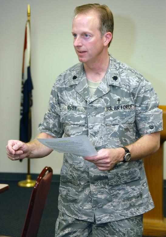 Lt. Col. Scott Doby, 131st Bomb Wing chaplain, speaks to the audience at the Brown Bag Speaker Series luncheon Sept. 12. Chaplain Doby spoke about beating 'burnout' and overcoming gridlock. (Photo by Staff Sgt. Amber Hodges)
