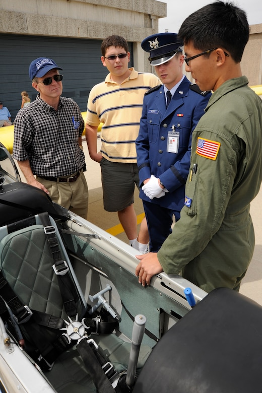 Cadet 3rd Class Woody go gives a brief overview and answers questions about glider operations for Paul Wurth, Rob Wurth and Cadet 4th Class Michael Wurth during Parents' Weekend Sept. 4, 2009. The freshman cadet and his family toured the airfield, which held an open house for cadets and their families. (U.S. Air Force photo/Dave Ahlschwede)