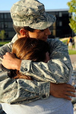 Prep School Cadet Candidate Clinton Ramos greets his mother, Lisa, with a big hug at the start of Parents' Weekend Sept. 4, 2009. Cadet Candidate Ramos is a Dallas native. (U.S. Air Force photo/Dave Ahlschwede)