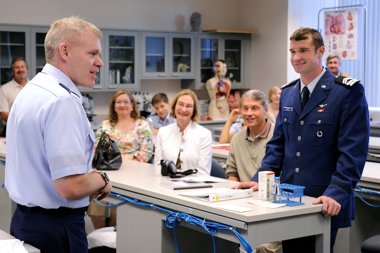Cadet 2nd Class Michael Cello and his family receive a briefing from biology instructor Lt. Col. Leon Barringer before a laboratory experiment Sept. 4. Families got to sit in classes with their cadets as part of Parents' Weekend. (U.S. Air Force photo/Mike Kaplan)