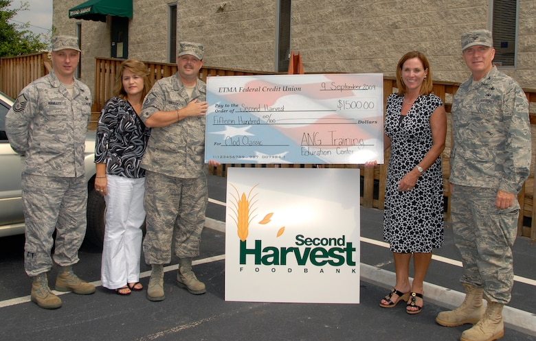 McGHEE TYSON AIR NATIONAL GUARD BASE, Tenn. --  Servicemembers from The I.G. Brown Air National Guard Training and Education Center present a check for $1,500 to the Second Harvest Food Bank of East Tennessee at its distribution center in Knoxville on Sept. 9.  The Training and Education Center raised the funds at their 2009 Clod Classic golf tournament, from left to right are Master Sgt. Harry E. Hamlett, Tammie S. Smeltzer, Master Sgt. Sam S. Daugherty, Elaine Streno, executive director of Second Harvest Food Bank of East Tennessee, and Col. Richard B. Howard. (U.S. Air Force photo by Staff Sgt. Jessica Parks)(Released)