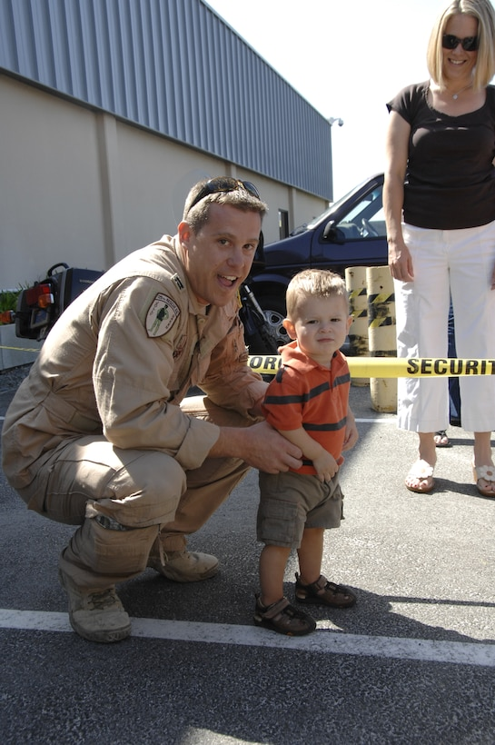 Capt. Nate Nowaski, an HH-60G Pave Hawk helicopter pilot from the 129th Rescue Squadron, is reunited with his son at Moffett Federal Airfield, Calif., after returning home from a four-month deployment to Afghanistan, Sept. 9. (Air National Guard photo by Tech. Sgt. Ray Aquino)