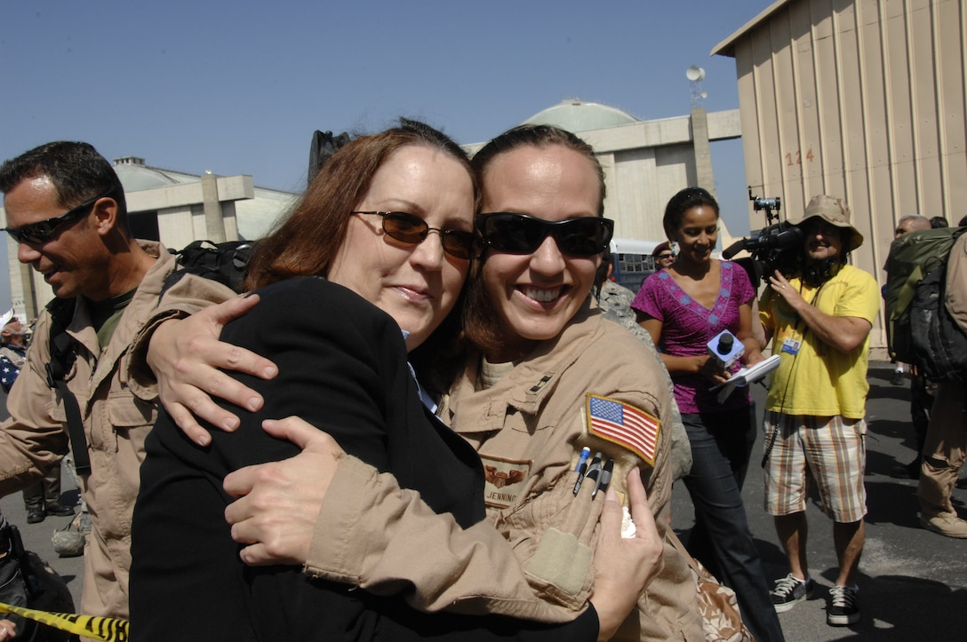 Capt. Mary Jennings, an HH-60G Pave Hawk helicopter pilot from the 129th Rescue Squadron, is greeted by her mom at Moffett Federal Airfield, Calif., after returning home from a four-month deployment to Afghanistan, Sept. 9. (Air National Guard photo by Tech. Sgt. Ray Aquino)
