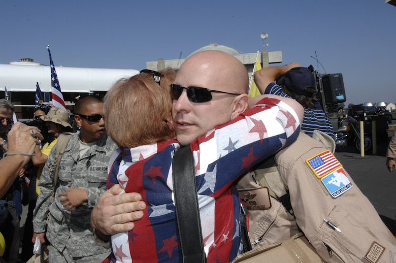 Senior Master Sgt. Jason Red, an HH-60G Pave Hawk helicopter aerial gunner superintendent from the 129th Rescue Squadron, is greeted by his mom at Moffett Federal Airfield, Calif., after returning home from a two-month deployment to Afghanistan, Sept. 9. (Air National Guard photo by Tech. Sgt. Ray Aquino)