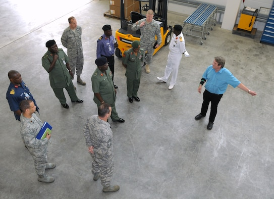 Mr. Ed Juko (left), Chief of Operations for Materiel Management at the 86th Logistics Readiness Group, shows the LRG's parts warehouse to a visiting delegation of Nigerian defense officials Sept. 11 at Ramstein. (USAF photo by Master Sgt. Jim Fisher)