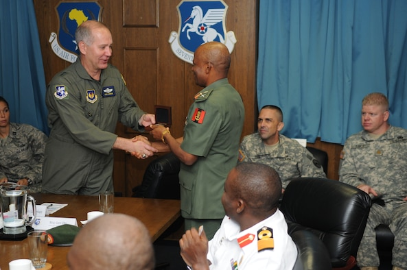 Air Forces Africa (17th Air Force) Commander Maj. Gen. Ron Ladnier presents the gift of a commemorative medallion to Nigerian army Chief of Training and Operations Maj. Gen. Moses Bisong Obi during a visit to Ramstein from a delegation of Nigerian military officials Sept. 11. (USAF photo by Master Sgt. Jim Fisher)