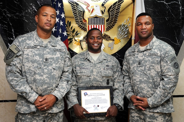 U.S. Army Central senior enlisted leaders stand proudly with Air Force Tech. Sgt. Kerry Thompson (center), from Camden, Ark., after the airman was awarded for exceptional performance as a military investigator at Camp As Sayliyah, Qatar, Aug. 27. Command Sgt. Maj. Todd S. Holiday, 513th Military Intelligence brigade, and Command Sgt. Maj. Michael D. Howard, Area Support Group Qatar, congratulated Thompson for earning the top Air Mobility Command leadership award for professionalism, selfless service and courage in combat. The prestigious Air Force Lance P. Sijan leadership award, named after a Medal of Honor recipient, recognizes airmen for remarkable performance and conduct. (Official Army Photo/ Dustin Senger)