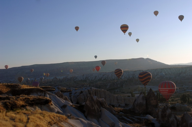 Hot air balloons soar over a valley  of the dramatic rock formations that form the famous moonscape of the region of Cappadocia, Turkey. (U.S. Air Force photo/Staff Sergeant Lauren Padden)