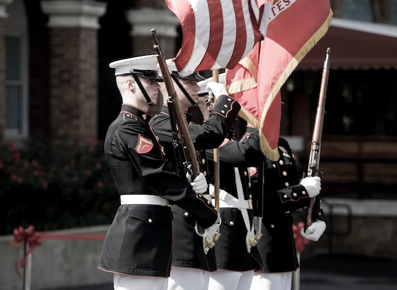 """The U.S. Marine Corps Color Guard performs during the dedication ceremony of Colonel Truman W. Crawford Hall at Marine Barracks Washington, Sept. 14. The hall will serve as the new headquarters and rehearsal area for """"The Commandant's Own."""""""