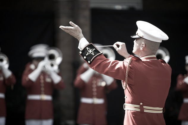 """Chief Warrant Officer Brian J. Dix, U.S. Marine Drum and Bugle Corps director, leads the unit in the national anthem during the dedication ceremony of Colonel Truman W. Crawford Hall at Marine Barracks Washington, Sept. 14. The hall will serve as the new headquarters and rehearsal area for """"The Commandant's Own."""""""