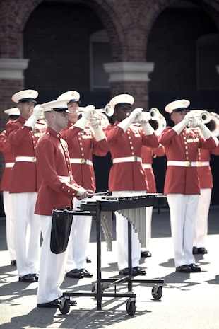 "The U.S. Marine Drum and Bugle Corps performs during the dedication ceremony of Colonel Truman W. Crawford Hall at Marine Barracks Washington, Sept. 14. The hall will serve as the new headquarters and rehearsal area for ""The Commandant's Own."""