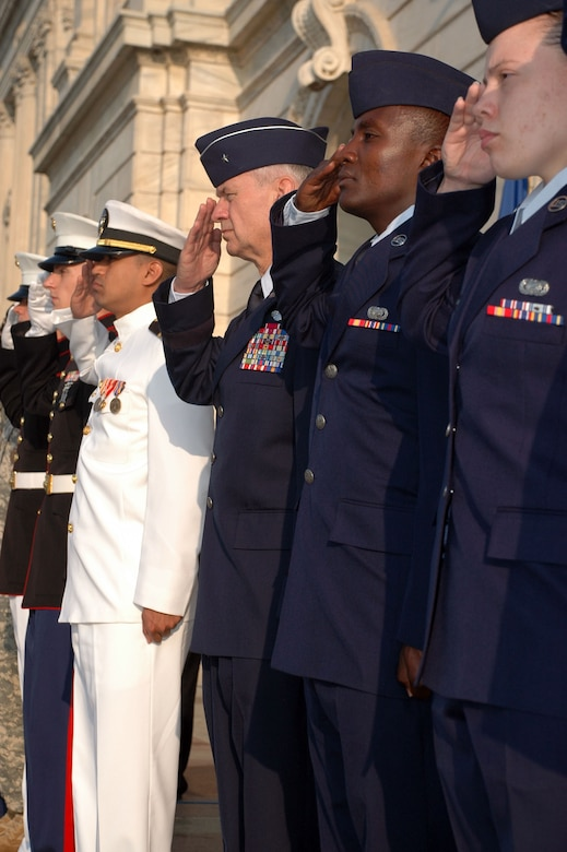 From Left to Right, Brig. Gen. Mark Johnson, Chief of Staff Air, Minn. Air National Guard, Senior Airman Sammy Muriuki, 934th Airlift Wing Communications Flight, and Senior Airman Amaris Carter, 934th CF salute at the Patriot Day 0-11 ceremony at the Minnesota state capitol. (Air Force Photo/Staff Sgt. Josh Moshier)