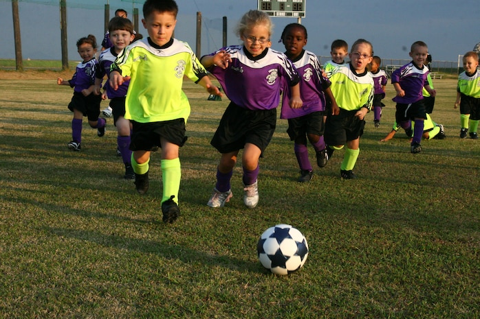 Players from the 3- to 4-year-old age division make a play toward the ball during the first week of the 2009 Youth Soccer season. The season kicked off with an opening ceremony at IronWorks Gym here Sept. 12.