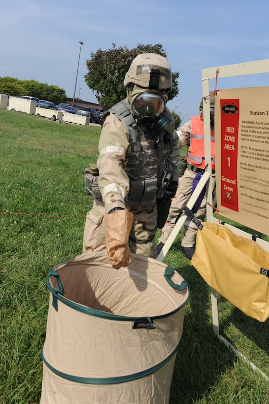 WHITEMAN AIR FORCE BASE, Mo. – a member of the 442nd Fighter Wing throws away a contaminated paper bag while possessing through a chemical line during an exercise, Sept. 16. The 442nd Fighter Wing has exercise to ensure their members remain current on their readiness training. (U.S. Air Force Photo/ SrA Cory Todd)