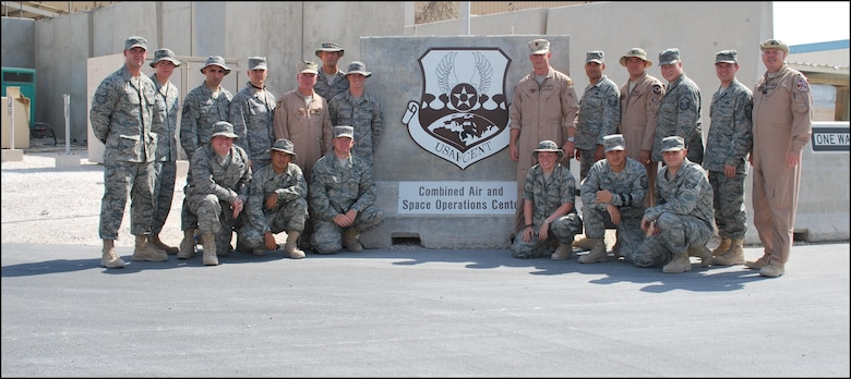 Maj. Robert O'Connor, 2nd Lt. Chad Montague, Master Sgt. Dan Hughes and Staff Sgt. Tim D'Amico of the 103rd Air intelligence Squadron and Master Sgt. Ben Abbot and Master Sgt. Pete Demakis of the 103rd Air Operations Squadron stand with their team members from the 710th Combat Operations Squadron and the 609th Air Operations Center Detachment 1 in front of the Combined Air Operations Center, Southwest Asia, early September 2009.  The team was tasked to field test command and control capabilities there.  (photo courtesy of 2nd Lt. Chad Montague)