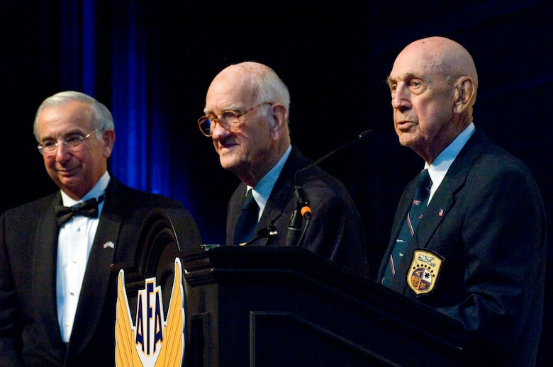 Joseph Sutter presents retired Maj. Thomas Griffin and retired Lt. Col. Richard Cole the Lifetime Achievement Award at the Air Force anniversary dinner Sept. 16, 2009, at the Gaylord National Hotel and Convention Center in National Harbor, Md. Major Griffin and Colonel Cole are members of the Doolittle Raiders. Mr. Sutter is the Air Force Association chairman of the board. The dinner was the end of the 2009 Air Force Association Air & Space Conference and Technology Exposition. (U.S. Air Force photo/Staff Sgt. Desiree N. Palacios)