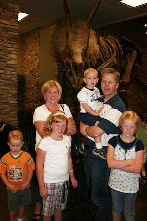 LEHI, Utah ? Master Sgt. Jeff Gustafson, 191st Air Refueling Squadron, and his wife Kristine pose with their family at the Museum of Ancient Life at Thanksgiving Point.  Sergeant Gustafson visited the museum as part of a free opportunity offered through Operation Military Kids this summer.  In Utah, OMK offers children and youth of all the military branches many opportunities for support and recreation.