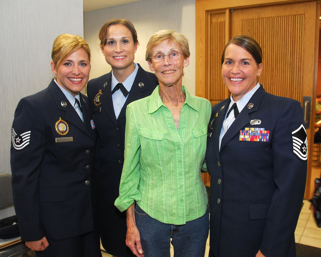 Technical Sgt. Nicole Crivello, left and Master Sgts. Patricia Gross and Angela Petri were honored by the City of Cudahy for potentially saving the life of Linda Provolo, center  September 15, 2009. The three airmen from the 128th Air Refueling Wing, Milwaukee where honored in a city  resolution citing an act of heroism for performing CPR and saving Linda Provolo who had collapsed and suffered a heart attack outside her home. (U.S. Air Forces photo by Staff Sgt. Nathan Wallin/Released)