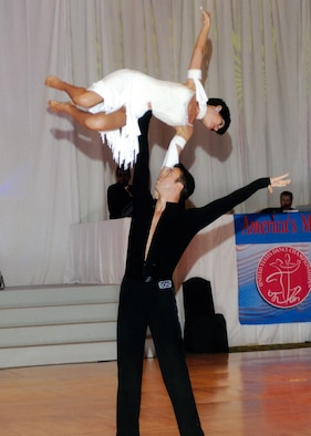Capt. John J. Scheuren and his partner, Georgia Ambarian, perform a dramatic overhead lift in the U.S. National Open and Pro/Am Championships Sept. 12 in Orlando, Fla. Captain Scheuren, a two-time dance champion, reclaimed his title in the cabaret category, after taking second place last year. Formerly stationed at Eglin AFB with the 28th Test and Evaluation Squadron, 53rd Wing, Captain Scheuren is an analyst with the Joint Test and Evaluation Program Office in Suffolk, Va.
