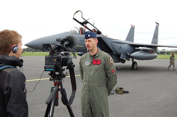 """Lt. Col. John """"Bugs"""" Bunnell, 494th Fighter Squadron commander, is interviewed by NATO Television reporter David Heathfield, at the airport in Tallinn, Estonia Monday.  Lieutenant Colonel Bunnell, had just landed his F-15 Strike Eagle after completing day one of NATO's Baltic Region Training Event IV Alpha. (U.S. Air Force Photo by Master Sgt. Gino Mattorano)"""