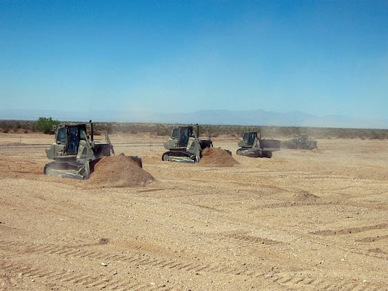 Marine Wing Support Squadron 374 heavy equipment operators remove dirt from and level an unmanned aircraft system runway at the Chocolate Mountain Aerial Gunnery Range in Calif., Sept. 21, 2009. The runway, which was the first built for UASs on the ranges of the Marine Corps Air Station in Yuma, Ariz., will open up new training opportunities for UASs visiting for the Weapons and Tactics Instructor course. Marine Unmanned Aerial Vehicle Squadron 1 will be the first squadron to use the runway during their training in the current WTI.