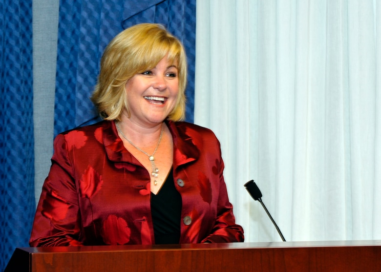Sharon O'Malley Burg, daughter of the late Gen. Jerome and Diane O'Malley, provides some remarks during the presentation of the 2009 General and Mrs. Jerome O'Malley Award to Brig. Gen. Brett and Marianne Williams at a ceremony in the Pentagon Sept. 11, 2009.  The award was established after General and Mrs O'Malley, who were known for their leadership and contributions to Air Force families and communities, were killed in a plane crash in 1985.  (U.S. Air Force photo/Michael Pausic)