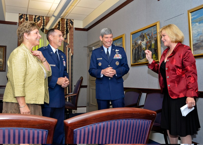 Sharon O'Malley Burg, daughter of the late Gen. Jerome and Diane O'Malley, makes a point during an informal conversation with Air Force Chief of Staff Gen. Norton Schwartz and Brig. Gen. Brett and Marianne Williams prior to the start of a ceremony at the Pentagon Sept. 11, 2009, honoring General and Mrs. Williams.  They are the recipients of the 2009 General and Mrs. Jerome O'Malley Award.  The award was established after the O'Malleys, who were known for their leadership and contributions to Air Force families and communities, were killed in a plane crash in 1985.  (U.S. Air Force photo/Michael Pausic)