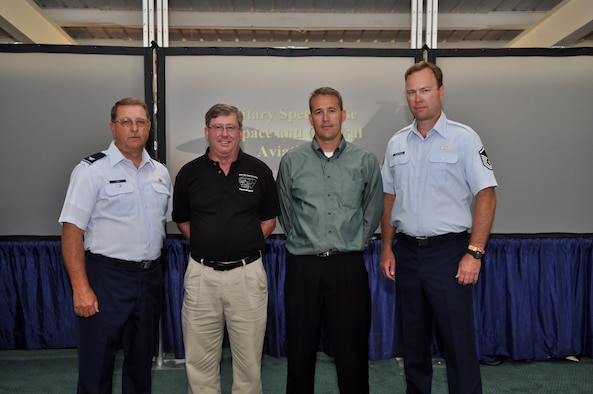 OSHKOSH, Wis. (Left to right) Col. Wayne Lee, Utah Air National Guard Headquarters, Mr. James Callahan, 57th Wing, Nellis Air Force Base,  Capt. Todd Lobato, 101st Information Operations Flight, Utah ANG, and Master Sgt. Hugh Marstella, 151st Air Refueling Wing flight safety, pose for a photo at a recent SeeAndAvoid.org ceremony here.  Captain Lobato was appointed as the DOD program manager for SeeAndAvoid.org on July 30.