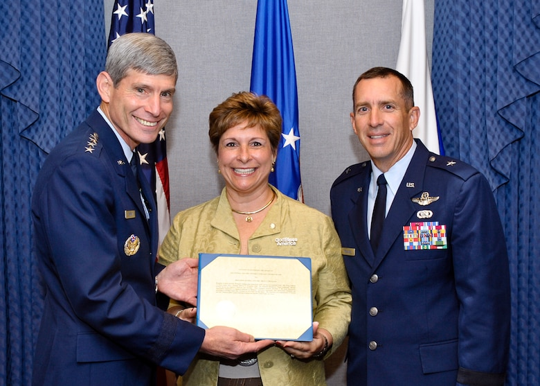 Air Force Chief of Staff Gen. Norton Schwartz presents the 2009 General and Mrs. Jerome F. O'Malley Award to Brig. Gen. Brett and Marianne Williams at a Pentagon ceremony Sept. 11, 2009.  (U.S. Air Force photo/Michael J Pausic)