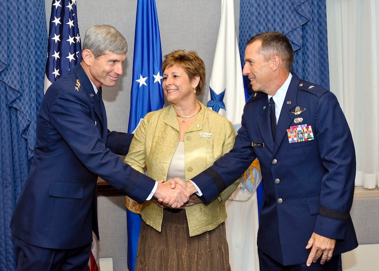 Air Force Chief of Staff Gen. Norton Schwartz congratulates Brig. Gen. Brett and Marianne Williams as the recipients of the 2009 General and Mrs. Jerome F. O'Malley Award during a Pentagon ceremony Sept. 11, 2009.  (U.S. Air Force photo/Michael J Pausic)