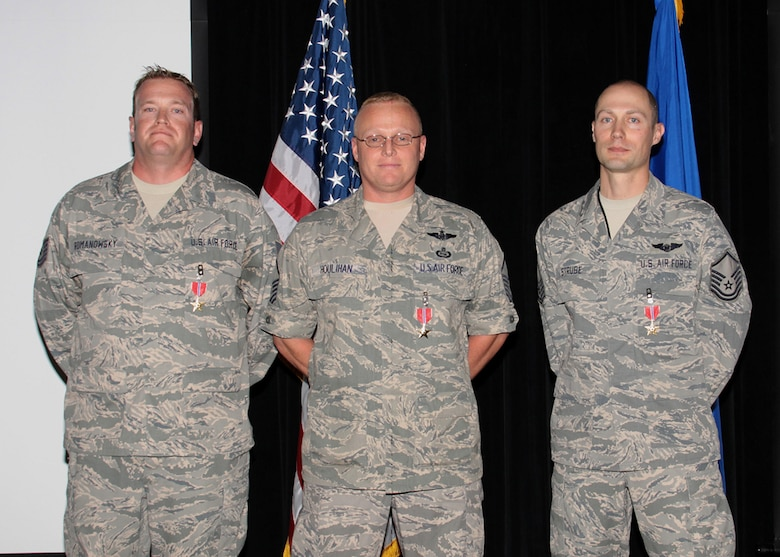 Tech. Sgt. David Romanowsky, Master Sgt. Joseph Houlihan and Master Sgt. Matthew Strube of the 566th Intelligence Squadron, each earned the Bronze Star Medal for their actions during recent deployments. Courtesy photo.