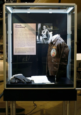 "DAYTON, Ohio -- ""Black Thursday"" exhibit in the World War II Gallery at the National Museum of the U.S. Air Force. The A-2 flying jacket, scarf and gauntlets on display were during the Schweinfurt mission worn by Phillip R. Taylor of Alameda, Calif., a waist gunner in a B-17 of the 91st Bomb Group. The firing pin is from the .50-cal. machine gun used by Taylor to shoot down an enemy Fw 190 fighter plane that attacked his B-17. Taylor's plane had more than 200 holes in it upon landing in England, and it never flew again. (U.S. Air Force photo)"