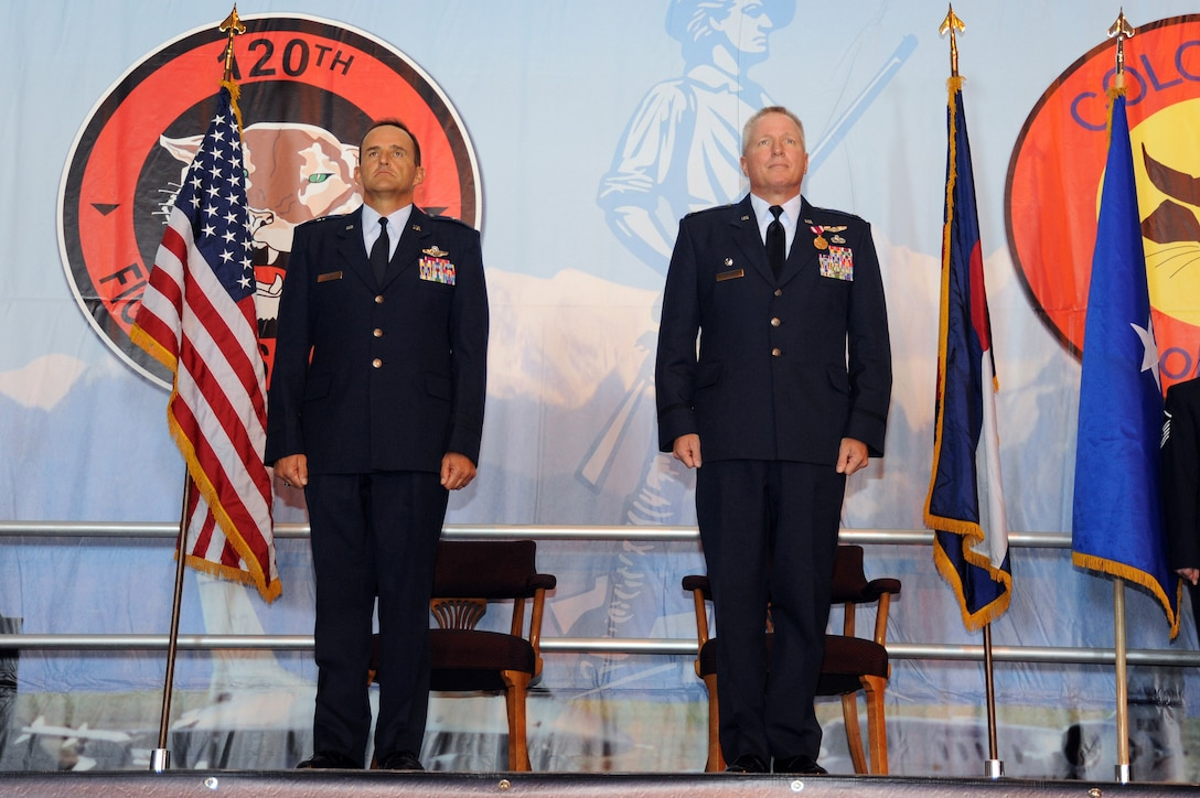 Brig. Gen. Trulan Eyre, Commander of the 140th Wing, along with Lt. Col. Thomas Shetter, Commander of the 140th Maintenance Group, stand at attention as the orders for promotion are read September 19, 2009 Buckley Air Force Base, CO.  Shetter was promoted to the rank of Colonel after 24 years of dedicated leadership. (U.S. Air Force photo by Tech Sgt. Wolfram M. Stumpf, Colorado Air National Guard/Released)