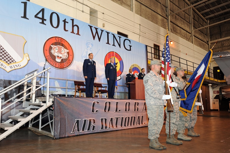 Brig. Gen.l Trulan Eyre, Commander of the 140th Wing, along with Lt. Col. Thomas Shetter, Commander of the 140th Maintenance Group, stand at attention during the National Anthem September 19, 2009 Buckley Air Force Base, CO.  Shetter was promoted to the rank of Colonel after 24 years of dedicated leadership. (U.S. Air Force photo by Tech Sgt. Wolfram M. Stumpf, Colorado Air National Guard/Released)