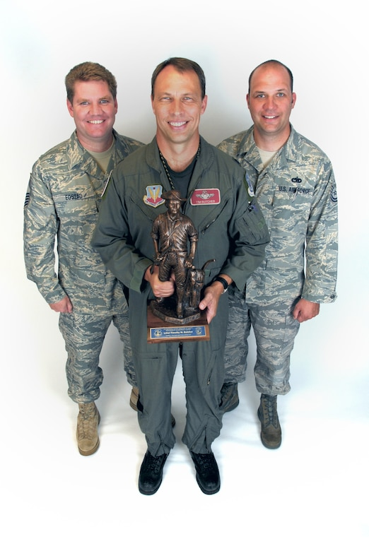 Senior Master Sgt. Thomas Egstad, left, and Tech. Sgt. Jason Kasten, right, stand with Lt. Col. Timothy Butcher after Butcher was presented wtih the Air National Guard Outstanding Safety Achievement Award.  (U.S. Air Force photo by Staff Sgt. Ashley Bell)