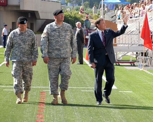 Utah Governor Gary R. Herbert waves to the crowd alongside Maj. Gen. BrianTarbet, the Adjutant General of Utah, and Brig. Gen. Michael Liechty, commander, Utah NG Land Component Command, at the Governor's Day celebration held on September 19 at the Rice Eccles Stadium. Approximately 5,300 Utah Air and Army Guardsmen participated in the event. U.S. Air Force photo by Staff Sgt. Emily Monson.