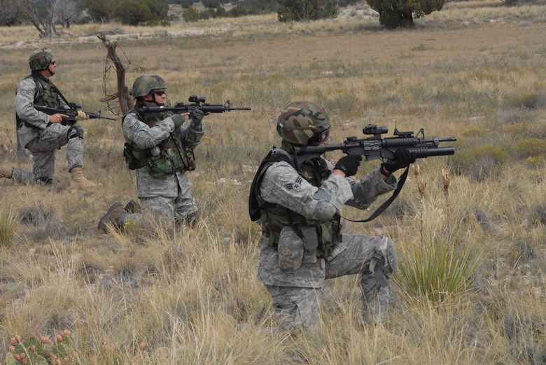 With weapons ready, Airmen of the 140th Security Forces Squadron practice combat formations prior Sept. 12, 2009 at the Airburst Range in Fort Carson, Colo. this portion of the training exercise, Airmen are learning how to negotiate the unstable terrain, while moving together and staying in formation. (Official U.S. Air Force photo by Staff Sgt. Armando Argiz, Colorado Air National Guard/Released)
