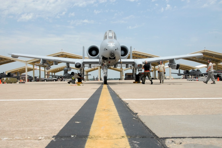 Maintenance crews from the 442nd Fighter Wing's 442nd Maintenance Group prepare an A-10 for flight July 12, 2009, during an exercise to practice for the wing's upcoming operational readiness inspection in October.  In a program initiated by the 442nd Chaplain's office, wing members will be able to offer up prayers for A-10 pilots and ground crews to help fly the required number of sorties during the inspection.  (U.S. Air Force photo/Staff Sgt. Kent Kagarise)