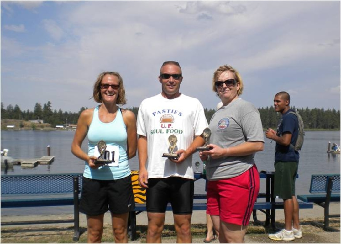Maj. Sandy Smith, 141 FSF commander, Col. Robert Aunan, 141 ARW vice commander, and MSgt Gladys Shirey, 141 ARW retention office manager, hold trophies won after taking first place in the relay division at the 2009 Clear Lake Triathlon. The triathlon was hosted by the 92nd Force Support Squadron.