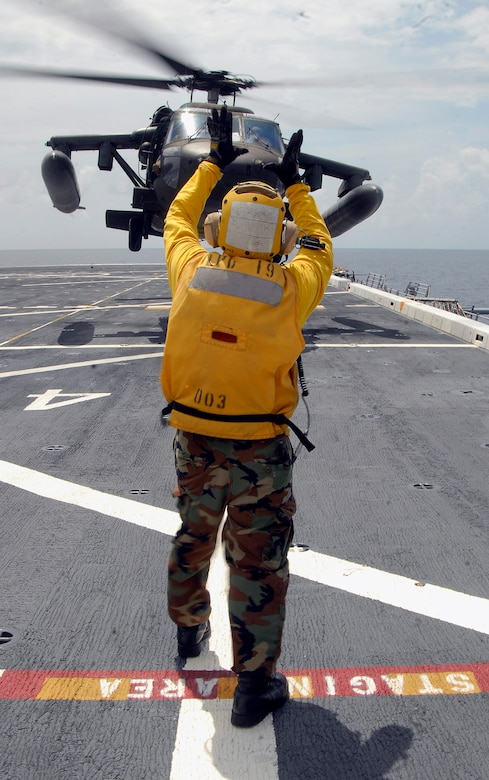 USS MESA VERDE, Panama — An Air department landing signal enlisted Sailor guides an Army UH-60 Blackhawk, assigned to Joint Task Force-Bravo, as it lifts off the flight deck of the amphibious dock landing ship USS Mesa Verde (LPD 19) during deck landing qualifications Sept. 14.  Mesa Verde is underway for Fuerzas Alidas (FA) PANAMAX 2009.  FA PANAMAX is an annual U.S. Southern Command joint and multi-national training exercise tailored to the defense of the Panama Canal, involving civil and military forces from around the world. (U.S. Navy photo/Mass Communication Specialist 3rd Class Patrick Grieco).