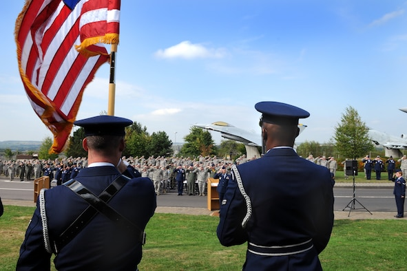 SPANGDAHLEM AIR BASE, Germany -- Members of the 52nd Fighter Wing Honor Guard post the colors as members of the 52nd FW salute during the POW/MIA ceremony at the Air Park Sept. 18. The ceremony is held every year to remember those who have served and been taken prisoners of war or have been listed as missing in action. (U.S. Air Force photo/Airman 1st Class Nathanael Callon)