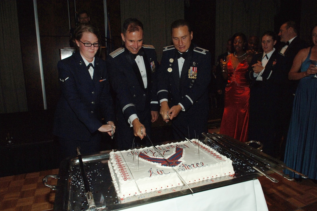 Airman Samantha Sharp, 460th Force Support Squadron, Brig. Gen. Kevin Pottinger, ARPC commander, and Col. Clint Crosier, 460th Space Wing commander, cut the Air Force birthday cake at the ball. (U.S. Air Force photo by Tech. Sgt. Shirley Henderson)
