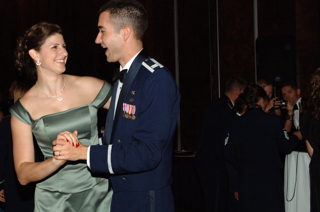 Capt Paul Muller, Det. 45, and his wife Amanda enjoy a moment at the Air Force Ball.  The ball, which was a celebration of the 62nd anniversary of the U.S. Air Force, was held at the Brown Palace. (U.S. Air Force photo by Tech. Sgt. J. LaVoie)